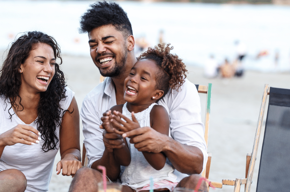 young family at the beach